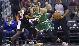 Boston Celtics forward Jayson Tatum (0) drives against Washington Wizards guard John Wall (2) during the first half of an NBA basketball game Wednesday, Dec. 12, 2018, in Washington. (AP Photo/Alex Brandon)