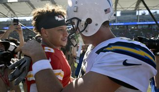 FILE - In this Sunday, Sept. 9, 2018, file photo, Kansas City Chiefs quarterback Patrick Mahomes, left, greets Los Angeles Chargers quarterback Philip Rivers after a win in an NFL football game in Carson, Calif. The Kansas City Chiefs are missing their star running back, likely without his backup and could have their top two wide receivers hobbled or shelved for their crucial AFC West showdown against the Los Angeles Chargers on Thursday, Dec. 13. (AP Photo/Kelvin Kuo, File)
