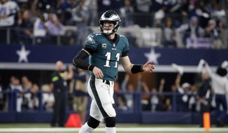 Philadelphia Eagles quarterback Carson Wentz (11) walks off of the field after he fumbled the ball and the Dallas Cowboys recovered during the first half of an NFL football game, in Arlington, Texas, Sunday, Dec. 9, 2018. (AP Photo/Michael Ainsworth) **FILE**
