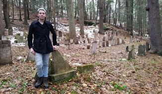 In this Nov. 2018 photo, Tom Vaughn, 20, of Plymouth, Conn., poses at Hillside Cemetery in Thomaston, Conn, which he is voluntarily cleaning up. Vaughn found in May that many of the 200-plus headstones had either fallen down or were knocked down. Not all stones were placed in the right spots, despite the town having kept excellent records of those buried in town. (Kurt Moffett/Republican-American via AP)
