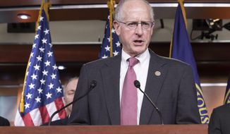 FILE - In this May 16, 2018, file photo, House Agriculture Committee Chairman Mike Conaway, R-Texas, speaks about the farm bill during a news conference on Capitol Hill in Washington. The House easily passed on Dec. 12, the farm bill, a massive legislative package that reauthorizes agriculture programs and food aid. (AP Photo/J. Scott Applewhite, File)