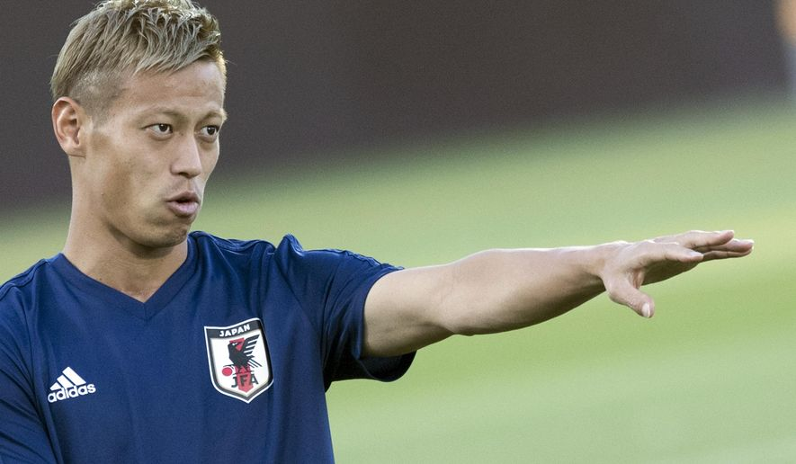 "FILE - In this July 1, 2018, file photo, Japan's Keisuke Honda gestures during an official training of Japan on the eve of the round of 16 match between Belgium and Japan at the 2018 soccer World Cup in the Rostov Arena in Rostov-on-Don, Russia. Not long after Japanese midfielder Honda joined the Melbourne Victory, he mentioned at the A-League season launch that ""I've made people disappointed, I've made people happy ... I don't have any magic."" Seven matches into the season, the 32-year Honda is providing plenty of spark and experience for the second-place Victory, and, despite his comments, a bit of magic and passion for his team and A-League fans. (AP Photo/Pavel Golovkin, File)"