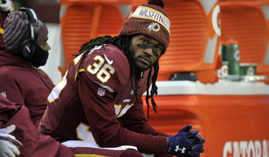 FILE - In this  Sunday, Dec. 9, 2018 file photo, Washington Redskins free safety D.J. Swearinger sits on the bench in the fourth quarter of an NFL football game against the New York Giants in Landover, Md. The Washington Redskins have lost four in a row, are down to their fourth quarterback and are mired in criticism from several players. A once-promising season has gone off the rails thanks to injuries all over the offense and a defense full of blown assignments and missed tackles. The finger-pointing is well underway for a team that has fallen to 6-7 and has plenty of blame to go around.(AP Photo/Mark Tenally, File)
