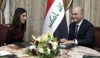 Nobel Peace Prize recipient Nadia Murad, left, meets with her country's President Barham Salih, in Baghdad, Iraq, Wednesday, Dec. 12, 2018. Murad received the prize in 2018 for her advocacy on behalf of victims of wartime sexual violence. Murad, a member of Iraq's Yazidi minority, was among thousands of women and girls who were captured and forced into sexual slavery by Islamic State militants in 2014. (AP Photo/Karim Kadim)