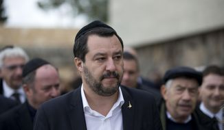 Italian Interior Minister and Deputy-Premier Matteo Salvini, wears a yarmulke during his visit to the Yad Vashem Holocaust Museum in Jerusalem, Wednesday, Dec. 12, 2018. (AP Photo/Oded Balilty)