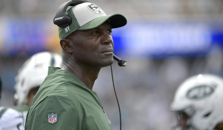 FILE - In this Sunday, Sept. 30, 2018 file photo, New York Jets head coach Todd Bowles watches from the sideline during the second half of an NFL football game against the Jacksonville Jaguars in Jacksonville, Fla. Todd Bowles' days as the New York Jets' coach are numbered in many people's minds and dwindling quickly. The embattled Bowles appears likely to be among those looking for new jobs the day the NFL's regular season ends, if not sooner. That uncertainty has not affected the coach's approach, even as rumors swirl about what many deem an inevitable unhappy ending. (AP Photo/Phelan M. Ebenhack, File)