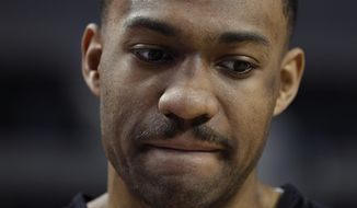 Jabari Parker of the Chicago Bulls speaks to journalists following a basketball practice at Mexico City Arena in Mexico City, Wednesday, Dec. 12, 2018. The Bulls will face Orlando Magic Thursday in the first of two 2018 regular-season NBA games to be played in the high-altitude Mexican capital. (AP Photo/Rebecca Blackwell)