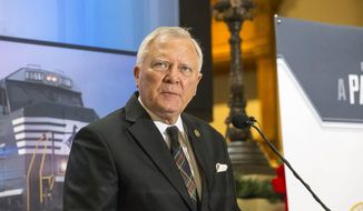 Georgia Governor Nathan Deal speaks during a press conference at the Georgia State Capitol building in Atlanta, Wednesday, December 12, 2018. Fortune 500 company Norfolk Southern officially announced Wednesday that they will be moving their headquarters to Atlanta. They will be building in Atlanta's Midtown community. (Alyssa Pointer/Atlanta Journal-Constitution via AP)