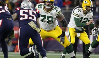 FILE - In this Sunday, Nov. 4, 2018  file photo, Green Bay Packers offensive tackle Jason Spriggs during an NFL football game against the New England Patriots at Gillette Stadium in Foxborough, Mass. Protecting quarterback Aaron Rodgers will be of the utmost importance for the Green Bay Packers when they face the Chicago Bears and their NFC-best defense on Sunday. The offensive line will be tested by a Bears defense that tripped up the high-octane Los Angeles Rams last week. The protection did hold up last week in the second half of a win over the Falcons last week, with backups playing at both guard spots and right tackle. (Winslow Townson/AP Images for Panini, File)
