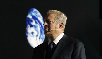 In this file photo, former U.S vice president and climate activist Al Gore makes a speech in a U.N. climate summit that is to work out ways of keeping global warming in check, in Katowice, Poland, Wednesday, Dec. 12, 2018. (AP Photo/Czarek Sokolowski) **FILE**