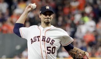 FILE - In this Wednesday, Oct. 17, 2018 file photo, Houston Astros starting pitcher Charlie Morton throws against the Boston Red Sox during the first inning in Game 4 of a baseball American League Championship Series in Houston. A person familiar with the agreement tells The Associated Press that All-Star pitcher Charlie Morton and the Tampa Bay Rays have reached a $30 million, two-year deal. The person spoke on condition of anonymity Wednesday, Dec. 12, 2018 because the contract has not been officially announced. (AP Photo/Frank Franklin II, File) **FILE**