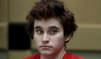 FILE - In this Tuesday, Nov. 27, 2018 file photo, Florida school shooting suspect Nikolas Cruz sits in the courtroom for issues dealing with procedural motions at the Broward Courthouse in Fort Lauderdale, Fla. There were plenty of missteps in communication, security and school policy before and during the Florida high school massacre that allowed a gunman to kill 17 people. The Marjory Stoneman Douglas High School Public Safety Commission will consider proposals Wednesday, Dec. 12, 2018, and Thursday, Dec. 13, including whether to arm trained teachers who volunteer. (Amy Beth Bennett/South Florida Sun-Sentinel via AP, Pool)