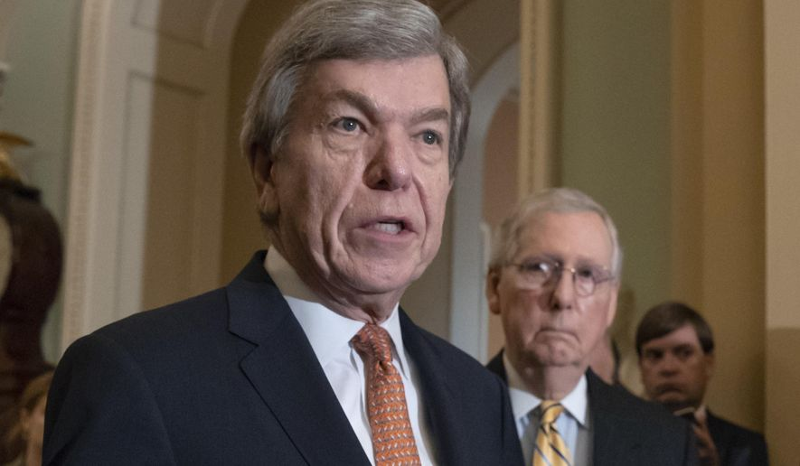 In this Aug. 21, 2018, file photo, Sen. Roy Blunt, R-Mo., speaks as Senate Majority Leader Mitch McConnell, R-Ky., listens at the Capitol in Washington. House and Senate negotiators have reached an agreement on a bill to overhaul the process for handling sexual misconduct allegations on Capitol Hill. The push for the legislation took on new urgency in the past year, as more than a half-dozen lawmakers resigned amid allegations of sexual misconduct. (AP Photo/J. Scott Applewhite, File)