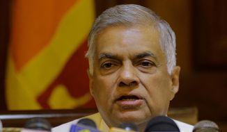 FIEL - In this Dec. 4, 2018, file photo, ousted Sri Lankan prime minister Ranil Wickremesinghe speaks during a media briefing in Colombo, Sri Lanka. The former Sri Lankan prime minister whose October sacking by the president precipitated a political crisis has won a confidence vote in Parliament. (AP Photo/Eranga Jayawardena, File)