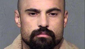 FILE- Michael Lee Crane of Mesa, Ariz., is shown in an undated file photo provided by the Maricopa County Sheriff's Office. Crane, the man charged with killing three people in burglaries nearly seven years ago in metro Phoenix has pleaded guilty to three unrelated burglaries. (Maricopa County Sheriff's Office via AP, file).