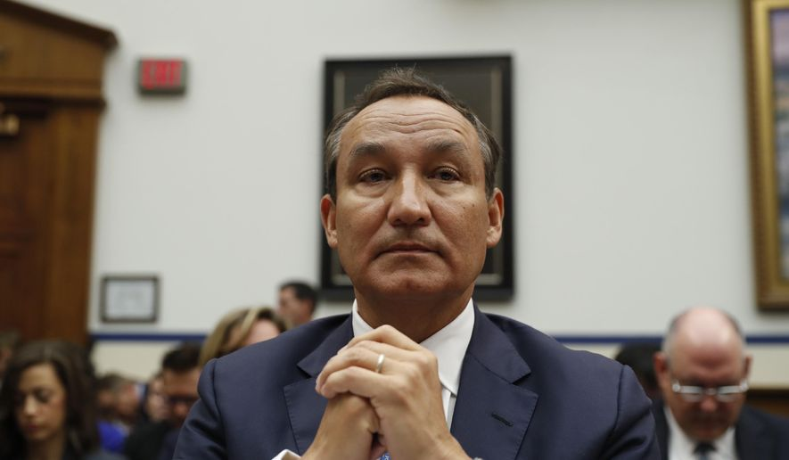 In this May 2, 2017, file photo, United Airlines CEO Oscar Munoz prepares to testify on Capitol Hill in Washington, before a House Transportation Committee oversight hearing. (AP Photo/Pablo Martinez Monsivais, File)