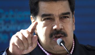 "Venezuela's President Nicolas Maduro speaks after voting in local elections in Caracas, Venezuela, Sunday, Dec. 9, 2018. Venezuelans head to the polls Sunday to elect local city councils amid widespread apathy driven by a crushing economic crisis and threats of expulsion by opposition groups for candidates who participate in what they consider an ""electoral farce."" (AP Photo/Ariana Cubillos)"