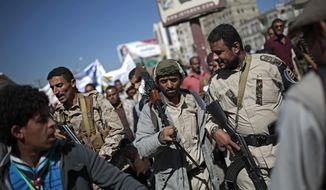 Houthi fighters take part in a protest calling for the reopening of Sanaa airport to receive medical aid, in front of the U.N. offices in Sanaa, Yemen, Monday, Dec. 10, 2018. (AP Photo/Hani Mohammed)