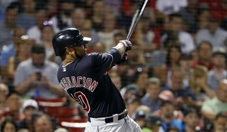 FILE - In this Aug. 22, 2018, file photo, Cleveland Indians' Edwin Encarnacion follows through on his second two-run home run of the night, during the fifth inning of a baseball game against the Boston Red Sox, in Boston. Edwin Encarnacion has been traded to Seattle and first baseman Carlos Santana has returned to the Indians in a three-team deal that also involved Tampa Bay. The Rays got infielder Yandy Diaz and minor league right-hander Cole Slusser from Cleveland. The Indians also acquired first baseman Jake Bauers. The swap came Thursday, Dec. 13, 2018,  at the close of the winter meetings. (AP Photo/Winslow Townson, File)