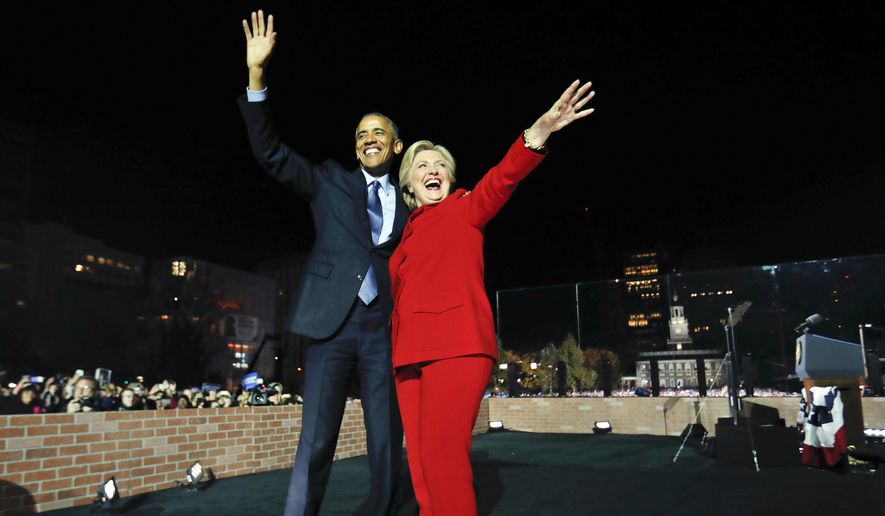 President Barack Obama waves on stage with Democratic presidential candidate Hillary Clinton during a rally at Independence Hall in Philadelphia, Monday, Nov. 7, 2016. (AP Photo/Pablo Martinez Monsivais)