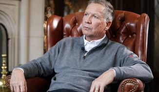 Ohio Gov. John Kasich sits for an interview with The Associated Press at the Ohio Governor's Residence and Heritage Garden, Thursday, Dec. 13, 2018, in Columbus. (AP Photo/John Minchillo)