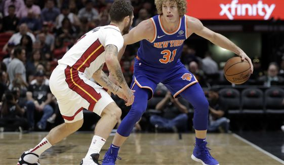 Miami Heat guard Tyler Johnson, left, defends New York Knicks guard Ron Baker (31) during the first half of an NBA basketball game, Wednesday, Oct. 24, 2018, in Miami. (AP Photo/Lynne Sladky) ** FILE **
