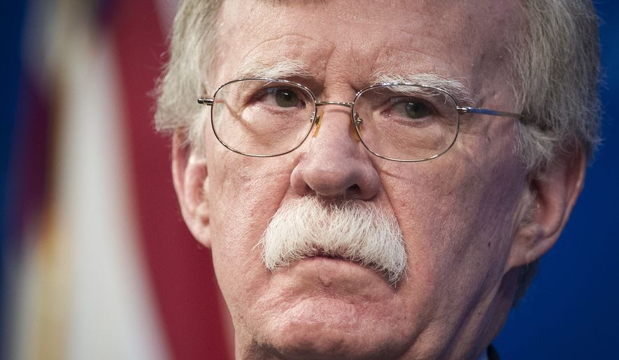 National Security Advisor John Bolton unveils the Trump Administration's Africa Strategy at the Heritage Foundation in Washington, Thursday, Dec. 13, 2018. (AP Photo/Cliff Owen)
