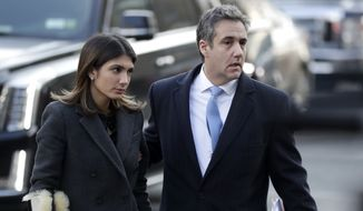 Michael Cohen, right, President Donald Trump's former lawyer, arrives at federal court with his daughter, Samantha Cohen, for his sentencing for dodging taxes, lying to Congress and violating campaign finance laws in New York on Wednesday, Dec. 12, 2018. (AP Photo/Julio Cortez)