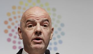 FIFA President Gianni Infantino speaks during a press conference at the G20 Leader's Summit in Buenos Aires, Argentina, Saturday, Dec. 1, 2018. (AP Photo/Natacha Pisarenko)