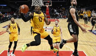 FILE - In this Friday, Dec. 7, 2018, file photo, Arizona State guard Luguentz Dort, second from left, shoots as Nevada forward Caleb Martin, right, defends during the first half of an NCAA college basketball game in Los Angeles. At 6-foot-4, 215 pounds, he's built like linebacker on the Arizona State football team, not some scrawny teenager disdainfully bumped out of the lane on a basketball court. (AP Photo/Mark J. Terrill, File)