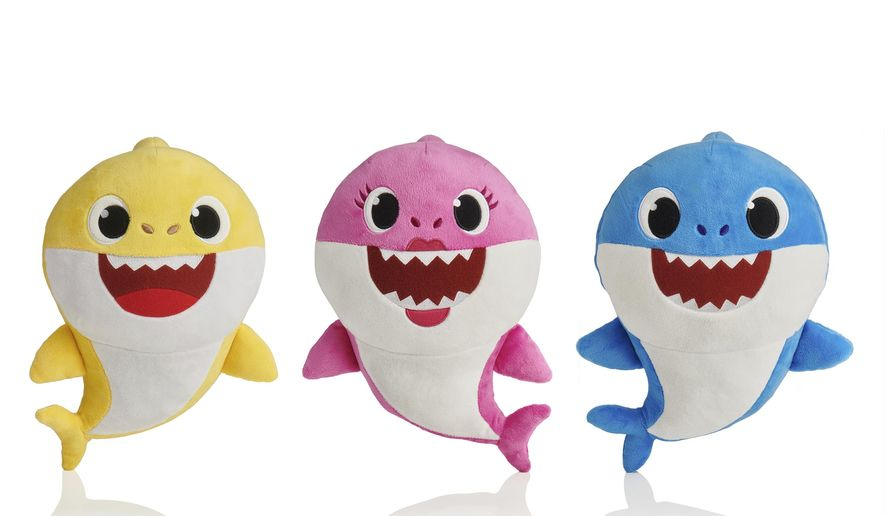 This picture shows the WowWee pinkfong Baby Shark family of singing plush toys. The viral song and its kiddie music videos have entranced toddlers and parents alike, though some of the grown-ups are now suffering from shark fatigue. (AP Photo/WowWee)