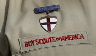 "FILE - In this Feb. 4, 2013 file photo, shows a close up detail of a Boy Scout uniform worn during a news conference in front of the Boy Scouts of America headquarters in Irving, Texas.  The Boy Scouts of America says it is exploring ""all options"" to address serious financial challenges, but is declining to confirm or deny a report that it may seek bankruptcy protection in the face of declining membership and sex-abuse litigation.  ""I want to assure you that our daily mission will continue and that there are no imminent actions or immediate decisions expected,"" Chief Scout Executive Mike Surbaugh said in a statement issued Wednesday, Dec. 12, 2018.    (AP Photo/Tony Gutierrez, File)"