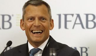 FILE - In this file photo dated  Friday, March 3, 2017, English Football Association , FA, CEO Martin Glenn during a press conference after the 131st International Football Association Board (IFAB) annual general meeting at Wembley stadium in London.  The FA announced Thursday Dec. 13, 2018, chief executive Martin Glenn will leave his job after four-years at the end of the season, in May 2019. (AP Photo/Frank Augstein, FILE)