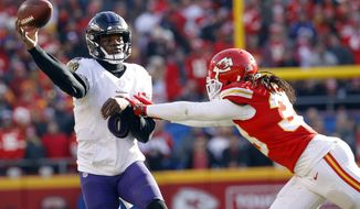 FILE - In this Dec. 9, 2018, file photo, Baltimore Ravens quarterback Lamar Jackson throws under pressure from Kansas City Chiefs safety Ron Parker (38) during the second half of an NFL football game, in Kansas City, Mo. With Jackson operating an effective run-pass option, Baltimore (7-6) has racked up 914 yards rushing over the past four games _ including 336 by its slashing, nimble quarterback. Tampa plays at Baltimore on Sunday.  (AP Photo/Charlie Riedel, File)