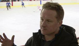 In this image made from video taken on March 11, 2016, entrepreneur Michael Spavor speaks during a friendly ice hockey match between visiting foreigners and North Korean players in Pyongyang, North Korea. A second Canadian man is feared detained in China in what appears to be retaliation for Canada's arrest of a top executive of telecommunications giant Huawei. The possible arrest raises the stakes in an international dispute that threatens relations. Canada's Global Affairs department on Wednesday, Dec. 12, 2018, said Spavor, an entrepreneur who is one of the only Westerners to have met North Korean leader Kim Jong Un, had gone missing in China. Spavor's disappearance follows China's detention of a former Canadian diplomat in Beijing earlier this week. (AP Photo)