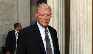 In this July 17, 2017, file photo, Sen. James Inhofe, R-Okla., leaves the Senate floor on Capitol Hill in Washington. (AP Photo/Manuel Balce Ceneta, File)