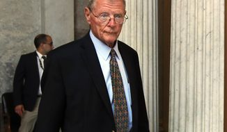FILE - In this July 17, 2017, file photo, Sen. James Inhofe, R-Okla., leaves the Senate floor on Capitol Hill in Washington. Inhofe, the chairman of the Senate Armed Services Committee, quickly unloaded newly acquired Raytheon stock following a report that the purchase was made after he urged President Donald Trump to boost defense spending by billions of dollars. (AP Photo/Manuel Balce Ceneta, file)