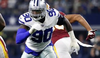 FILE - In this Thursday, Nov. 22, 2018, file photo, Dallas Cowboys defensive end Demarcus Lawrence (90) during the first half of an NFL football game against the Washington Redskins in Arlington, Texas. Dallas defensive coordinator Rod Marinelli remembers the night the Cowboys traded up in the second round of the 2014 draft to grab DeMarcus Lawrence because they thought he was the last pass rusher on the board with the skills to become elite. Four years and several significant draft decisions later, Dallas is in line for its highest defensive ranking since 2003. (AP Photo/Ron Jenkins, File)