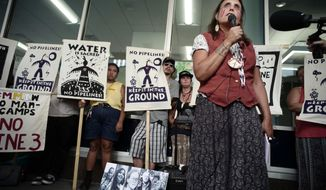 FILE - In this June 28, 2018, file photo, Winona LaDuke speaks out against the Line 3 decision in St. Paul, Minn. Opponents of Enbridge Energy's proposed Line 3 crude oil pipeline replacement are turning their attention to fighting the project on other fronts as a Minnesota regulatory panel prepares to take one of its final steps to allow it to proceed. (Richard Tsong-Taatarii/Star Tribune via AP, File)
