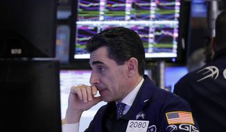 FILE- In this Dec. 6, 2018, file photo specialist Peter Mazza works at his post on the floor of the New York Stock Exchange. The U.S. stock market opens at 9:30 a.m. EST on Thursday, Dec. 13. (AP Photo/Richard Drew, File)