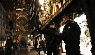 French gendarmes patrol in the streets of the city of Strasbourg, eastern France, following a shooting, Wednesday, Dec. 12, 2018. Police union officials identified the suspected assailant as Frenchman Cherif Chekatt, a 29-year-old with a thick police record for crimes including armed robbery and monitored as a suspected religious radical by the French intelligence services. (AP Photo/Christophe Ena)