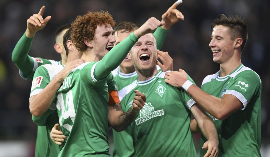 FILE - In this Dec 7, 2018 file photo Werder Bremen's Josh Sargent, left, celebrates with teammates after scoring a goal against Fortuna Duesseldorf during a Bundesliga soccer match in Bremen, Germany.  (Carmen Jaspersen/dpa via AP, file)