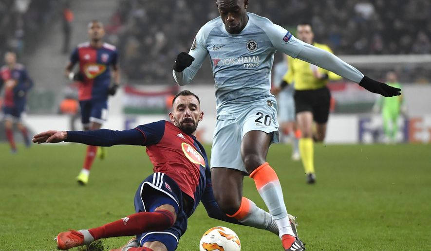 Vidi's Attila Fiola, left, in action against Chelsea's Callum Hudson-Odoi during the UEFA Europa League Group L soccer match between Vidi FC and Chelsea in Groupama Arena in Budapest, Hungary, Thursday, Dec. 13, 2018. (Tibor Illyes/MTI via AP)