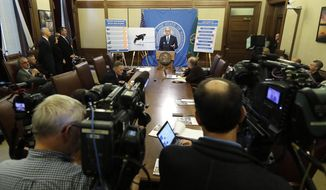 Washington Gov. Jay Inslee talks to reporters about his 2019-2021 budget proposal, Thursday, Dec. 13, 2018, at the Capitol in Olympia, Wash. (AP Photo/Ted S. Warren)