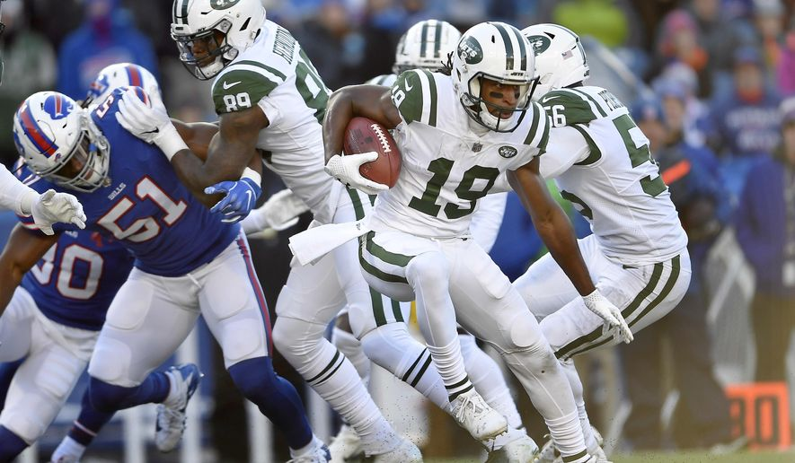 FILE - In this Sunday, Dec. 9, 2018, file photo, New York Jets' Andre Roberts (19) runs with the ball during the first half of an NFL football game against the Buffalo Bills in Orchard Park, N.Y. Roberts is a travelin' man who enjoys hitting the road. You name a destination and there's a good chance the Jets kick returner has been there. After all, Roberts has visited all seven continents. (AP Photo/Adrian Kraus, File)