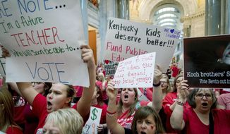 FILE - In this April 13, 2018, file photo, teachers from across Kentucky gather inside the state Capitol to rally for increased funding for education in Frankfort, Ky. The Kentucky Supreme Court has struck down a pension law that prompted thousands of teachers to protest at the state Capitol. (AP Photo/Bryan Woolston, File)