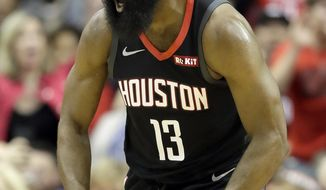 Houston Rockets' James Harden (13) reacts after dunking the ball against the Los Angeles Lakers during the first half of an NBA basketball game Thursday, Dec. 13, 2018, in Houston. (AP Photo/David J. Phillip)