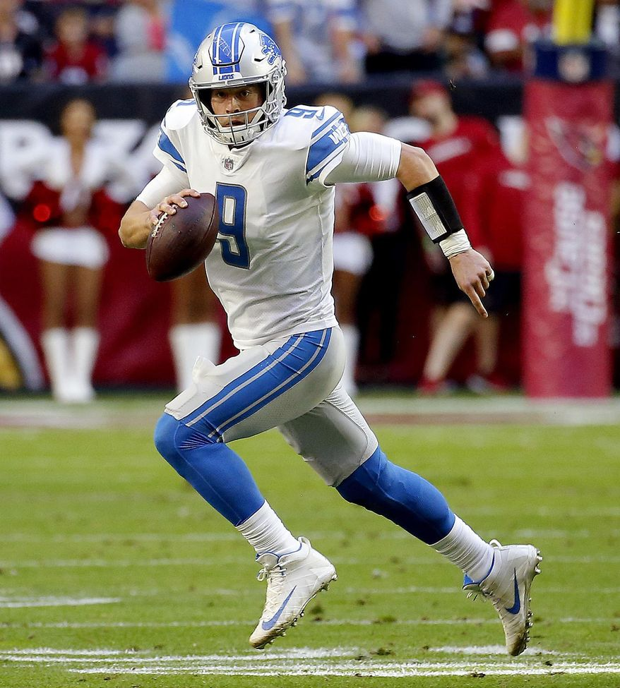 FILE - In this Dec. 9, 2018, file photo, Detroit Lions quarterback Matthew Stafford (9) scrambles against the Arizona Cardinals during the first half of NFL football game, in Glendale, Ariz. The Buffalo Bills (4-9) prepare to host the Detroit Lions (5-8) in a non-conference meeting of two teams under-going transitions. (AP Photo/Rick Scuteri, File)