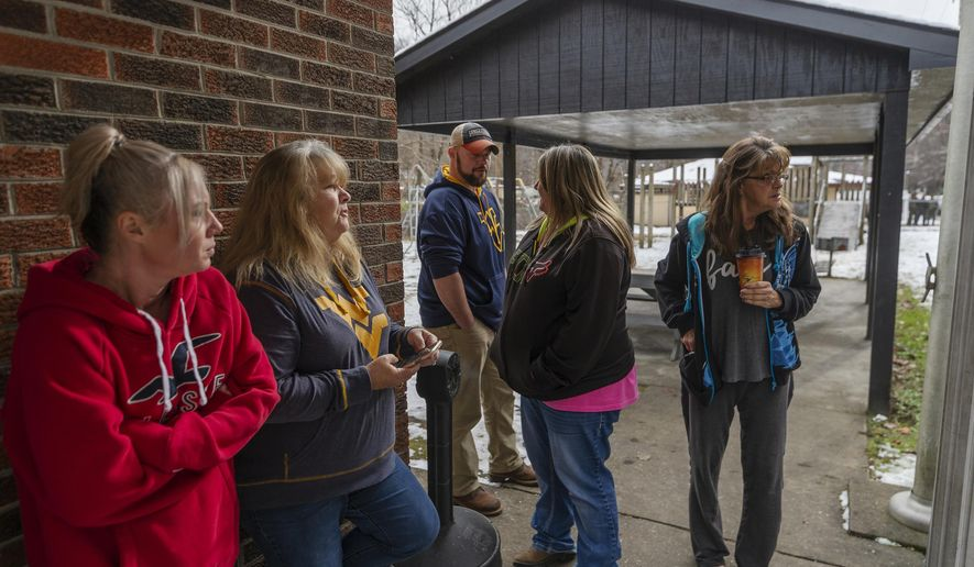 Family and friends await word of the search teams efforts in finding Cody Beverly, Kayla Williams and Erica Treadway at the Salamy Memorial Center in Whitesville, W.Va., on Wednesday, December 12, 2018. The three were reported missing Saturday night, and are stuck inside the Rock House Powellton mine. (Craig Hudson/The Charleston Gazette-Mail via AP)