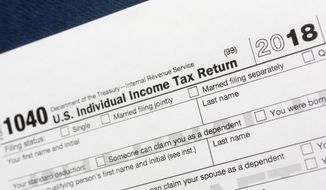FILE- This July 24, 2018, file photo shows a portion of the 1040 U.S. Individual Income Tax Return form for 2018 in New York. Setting money aside for the future is important, but where you store that money can make a huge difference in your tax bill. (AP Photo/Mark Lennihan, File)